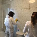 Boss gets her hand dirty removing mould in grout